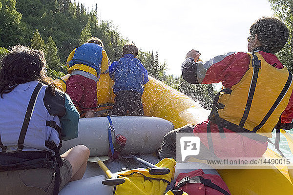 Family river rafting on Kenai River Kenai Peninsula Alaska Summer