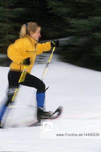 Woman Runs in Snowshoes Southcentral AK Winter