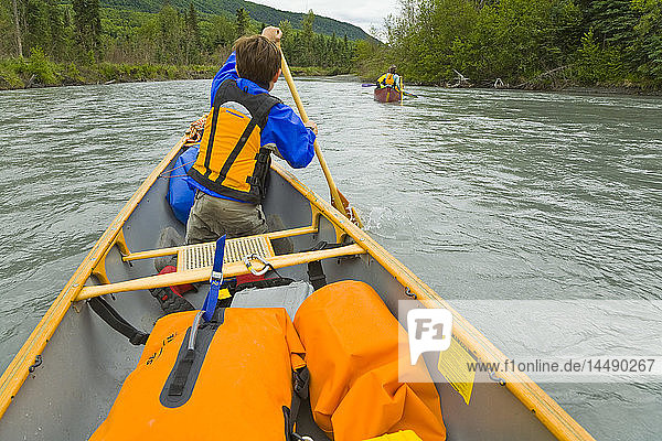 Two canoes on Eagle River in Chugach State Park during Summer in Southcentral Alaska