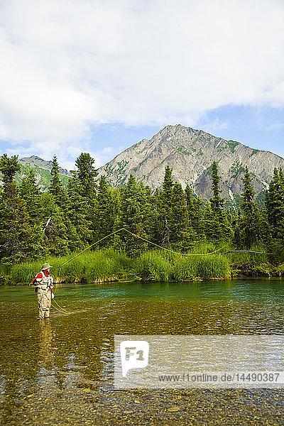 Person flyfishing in Kijik Lake in Lake Clark National Park in Southcentral Alaska during Summer