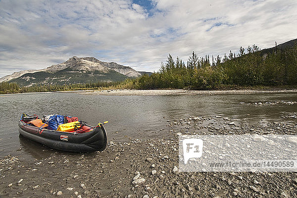 An inflatable canoe rests on the shore of the Alatna River during a backcountry trip in Gates of the Arctic National Park & Preserve  Arctic Alaska  Summer