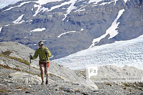 Woman hiking alongside Exit Glacier in the Harding Icefield  Kenai Fjords National Park  Kenai Peninsula  Southcentral Alaska  Summer