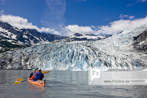 Couple kayaking in Shoup Bay with Shoup Glacier in the background  Prince William Sound  Southcentral Alaska