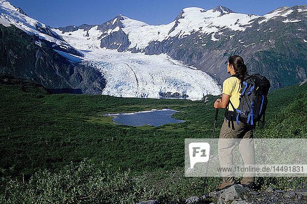 Woman Hiking at Portage Pass w/view of Glacier AK