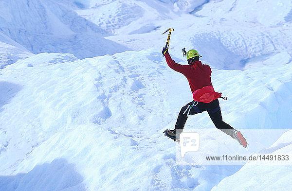 Ice Climber Jumping over Crevasse Matanuska Galcier AK Southcentral Chugach Mts Spring