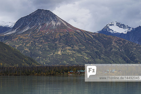 Scenic view of Redoubt Mountain Lodge on Crescent Lake with the Chigmit Mountains in the background  Southcentral Alaska  Autumn