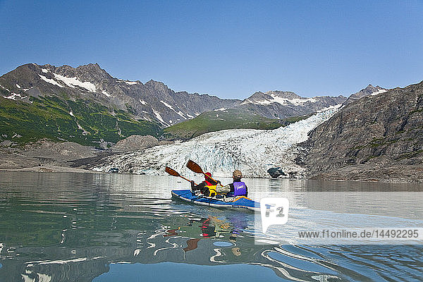 A Couple kayaking in Upper Shoup Bay  Shoup Glacier background  Shoup Bay State Marine Park  Prince William Sound  Alaska