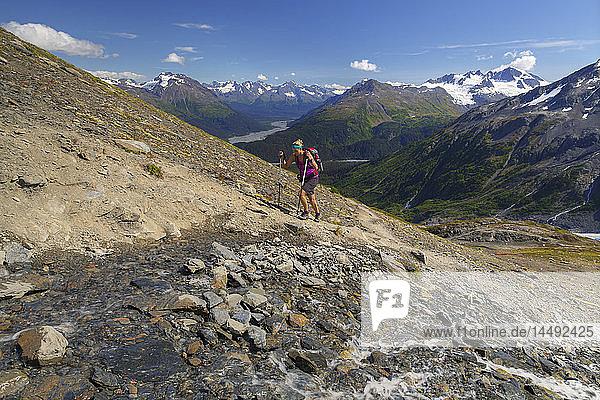 Woman hiking the Harding Icefield Trail in Kenai Fjords National Park near Seward  Kenai Peninsula  Southcentral Alaska  Summer  HDR