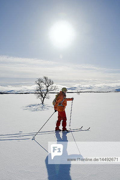 Woman hiking on snow