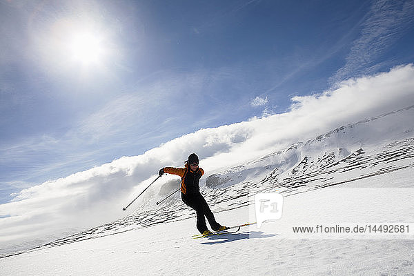 Woman skiing on snow covered slope