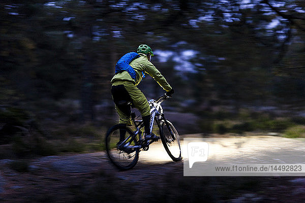 Man cycling through forest  Sweden
