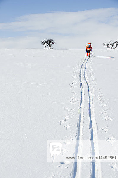 Woman hiking on snow
