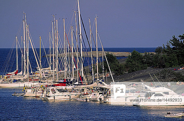 Sailing boats moored in bay