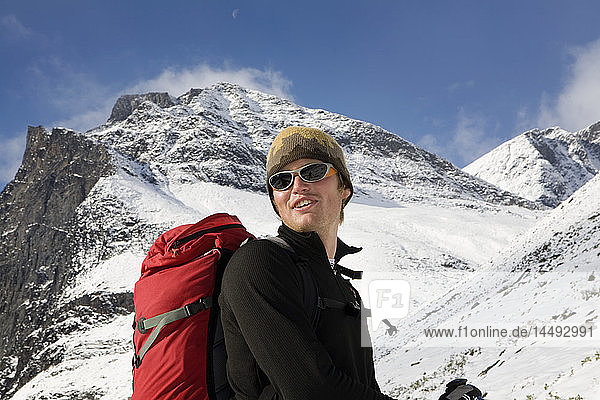 Man with rucksack at snowy Kebnekaise mountain