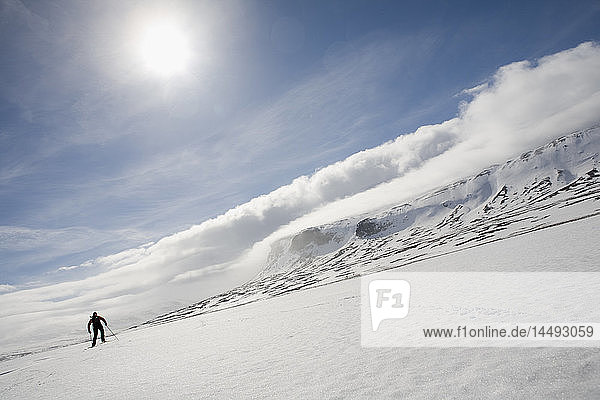 Person skiing on snow covered slope