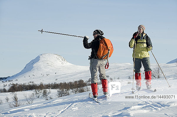 Man and woman skiing in snowcapped area