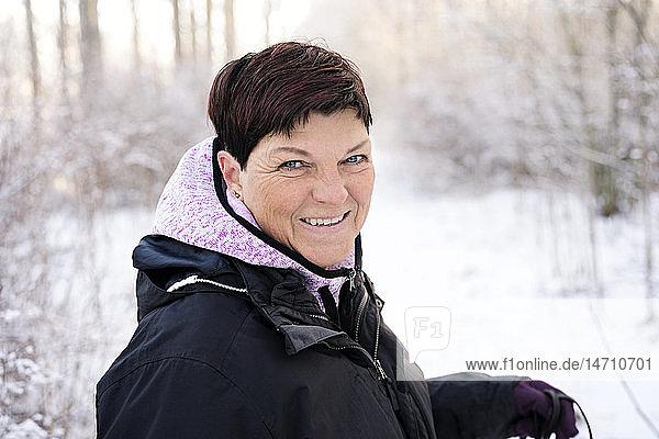 Smiling woman at winter