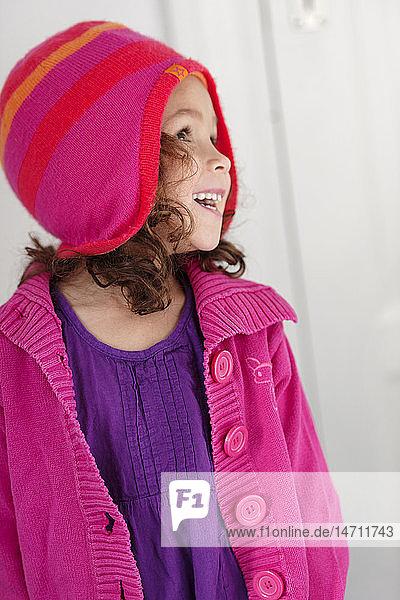 Girl wearing woolen hat looking away