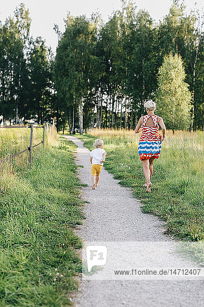 Mother with son walking