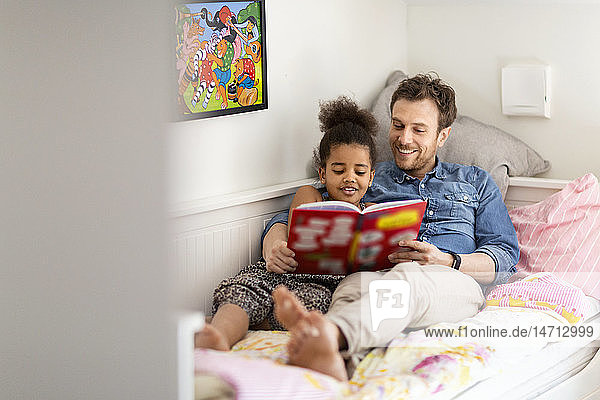 Father with daughter reading together