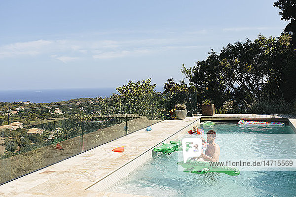 Father and son in swimming-pool