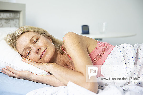Woman sleeping in her bed.