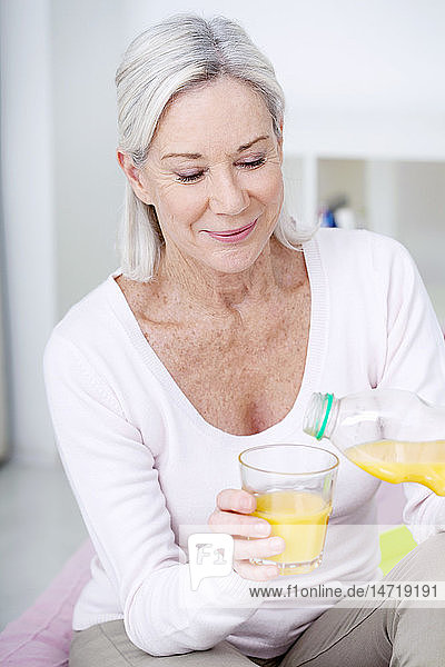 Elderly person with cold drink