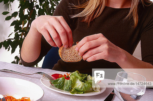 WOMAN EATING STARCHY FOOD