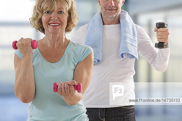 Senior couple practising sport.