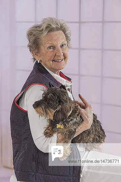 Senior woman with her dog.