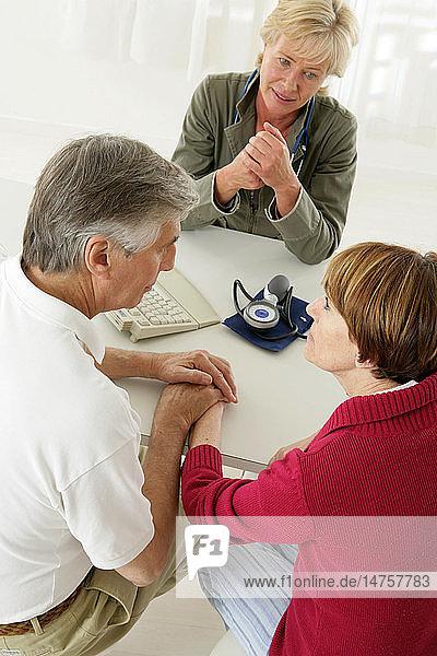 ELDERLY COUPLE IN CONSULTATION