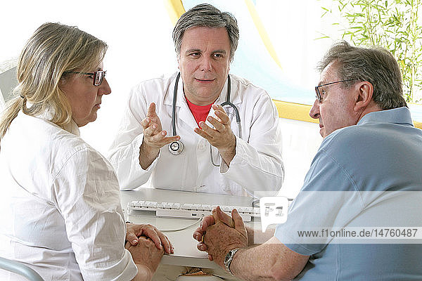 ELDERLY COUPLE AT HOSP. CONSULT.