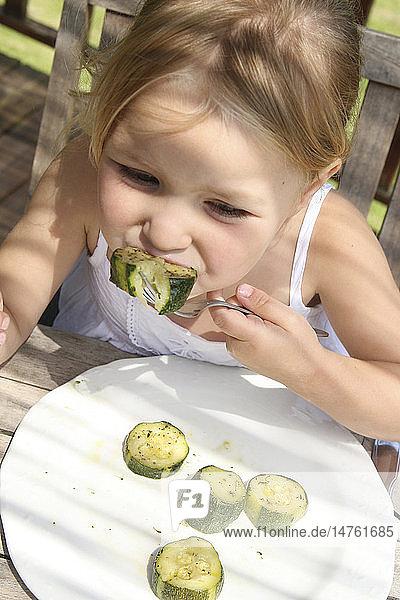 CHILD EATING VEGETABLE