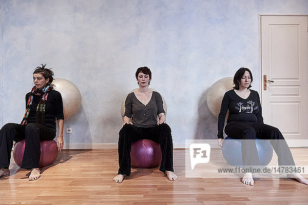 Reportage on a midwife in Lyon  France. Post-partum abdominal and pelvic floor group rehabilitation session. These exercises enable the women to feel their pelvic floor and become aware of its volume and elasticity in order to strengthen it. New born babies are welcome at these sessions.