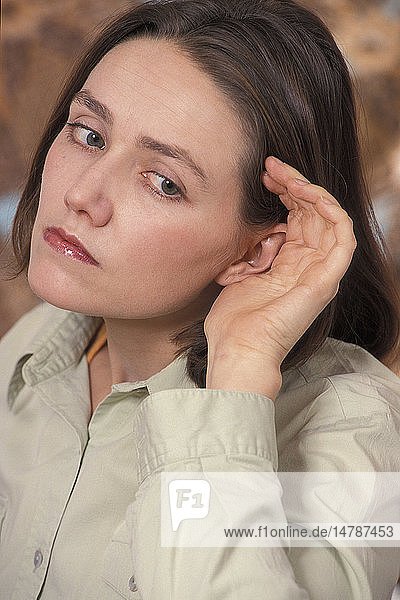 HEARING-IMPAIRED WOMAN