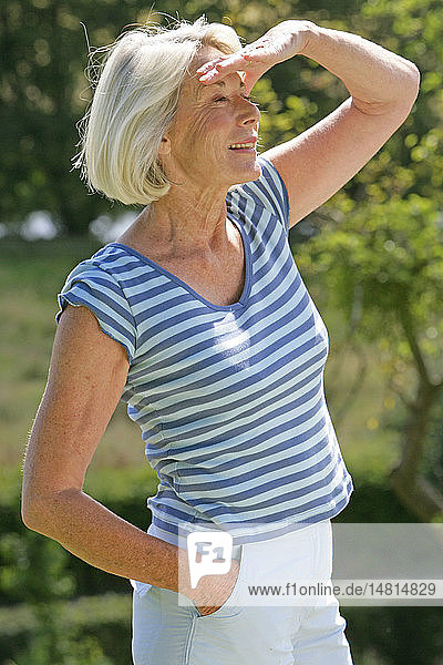 ELDERLY PERSON OUTDOORS