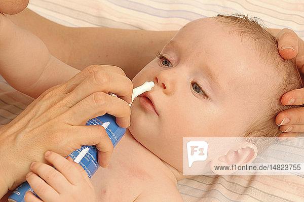 CHILD USING NOSE SPRAY