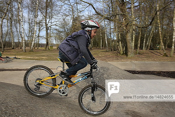 9-year-old boy on a bicycle.