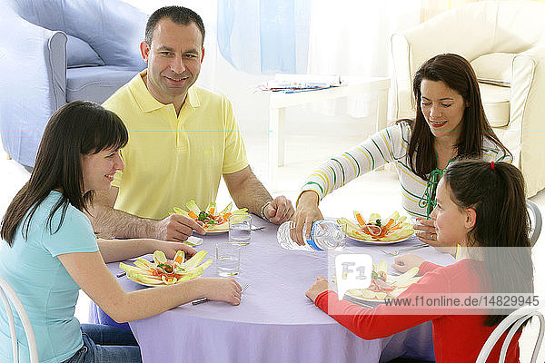 FAMILY EATING A MEAL
