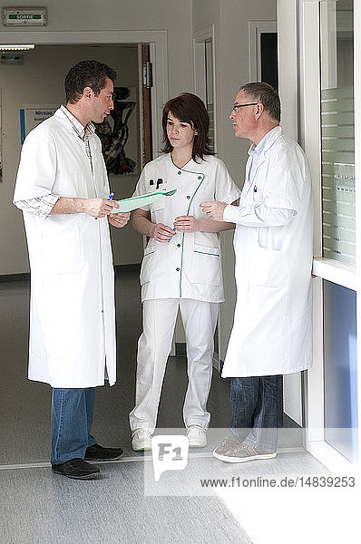 DOCTOR WITH MEDICAL RECORD