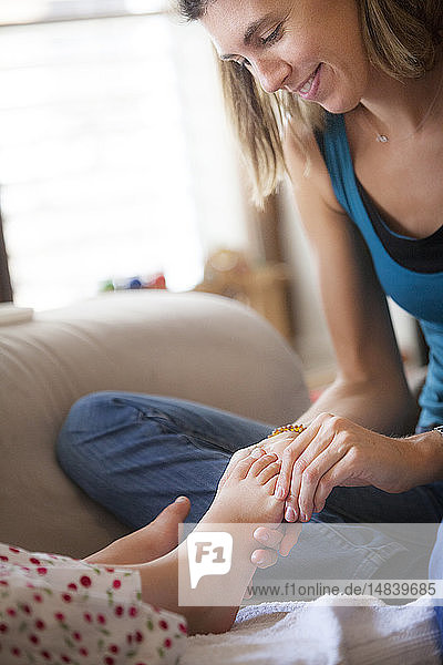 Reportage on foot reflexology for children. The reflexologist deals with children from the age of 5 upwards. Reflexology acts on their concentration  memory  balance  serenity and sleep. A 7-year old girl in a session.