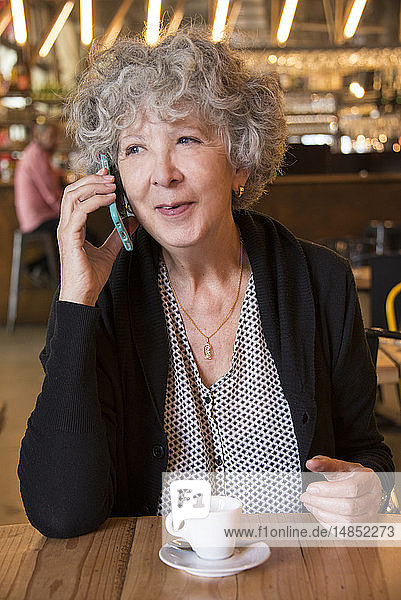 Senior woman in a cafe.