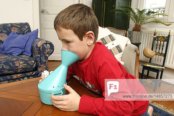 CHILD TAKING INHALATION