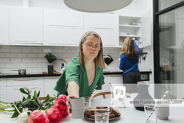 Teenage girl preparing table