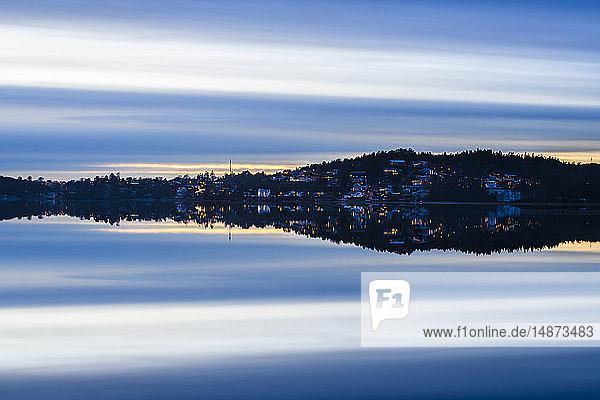 Village at sunset reflecting in lake