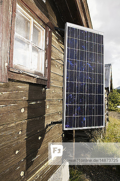 Solar panels on wooden house
