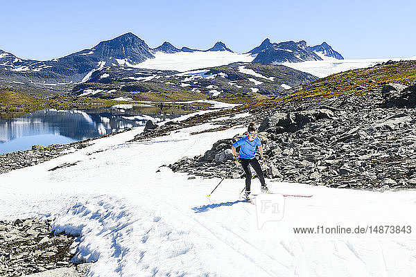 Boy cross-country skiing in mountains