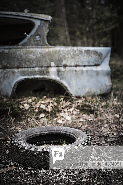 Tire near scrap car
