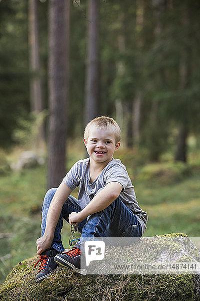 Boy posing in forest