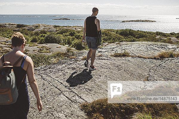 Friends walking at sea side
